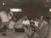 Party im zur Bar umgebautem ehemaligen Postraum (Kpt. Bergemann, 2. Ing. Peter Simmet mit seiner Frau Ute, 2. Offz. J. Pahl trinkend an der Bar)