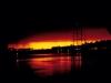"""Sonnenaufgang in Port au Prince, im Hintergrund Yacht des Präsidenten \""""Baby Doc\"""" (Foto von Eckart Bothe)"""